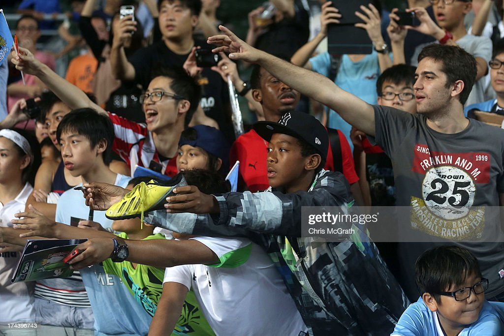 Fans try to get autographs after the Barclays Asia Trophy Semi Final match between Manchester City and South China at Hong Kong Stadium on July 24, 2013 in So Kon Po, Hong Kong.