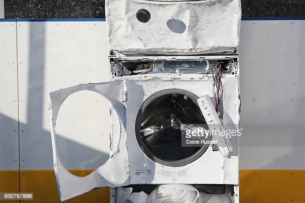 TORONTO ON JANUARY 1 Fans try to get pucks in a washer dryer just like Sydney Crosby did as a kid as the Toronto Maple Leafs play the Detroit Red...
