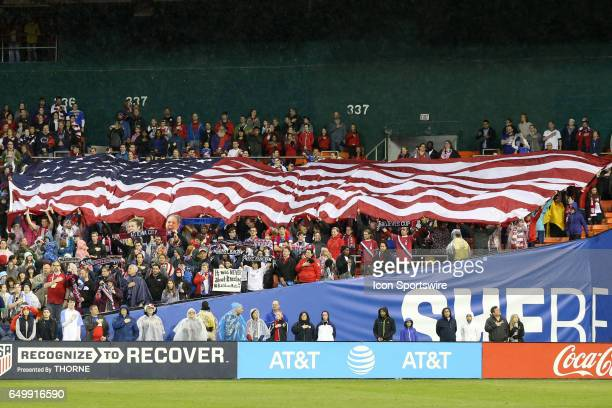 S fans unfurl a large American flag during the playing of the national anthem The United States Women's National Team hosted the France Women's...