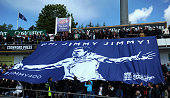 Fans unveil a banner after James Anderson of England claims his 400th test wicket during day one of 2nd Investec Test match between England and New...
