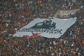 Fans unveil a banner for the photo journalist Erkan Koyuncu who lost his life in an unexpected accident at Galatasaray's training facilities in...