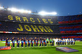 Fans unveil a mosaic tribute to the former FC Barcelona player and manager Johan Cruyff as the players shake hands before the La Liga match between...