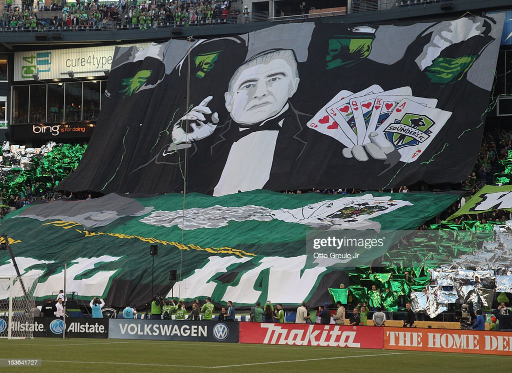 Fans unveil a royal flush banner honoring head coach Sigi Schmid of the Seattle Sounders FC prior to the match against the Portland Timbers at CenturyLink Field on October 7, 2012 in Seattle, Washington. The Sounders defeated the Timbers 3-0.