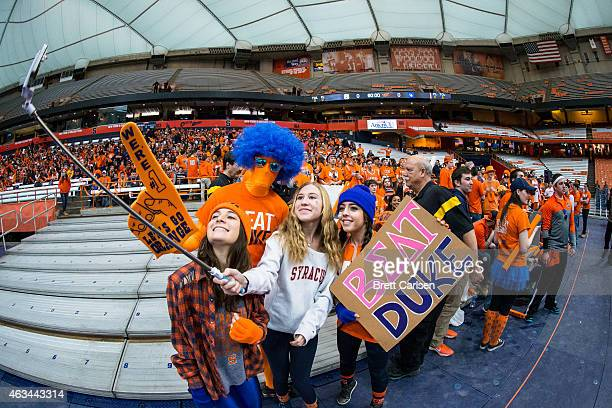 Fans use a selfie stick to photograph the Syracuse Orange student section before the game against the Duke Blue Devils on February 14 2015 at The...