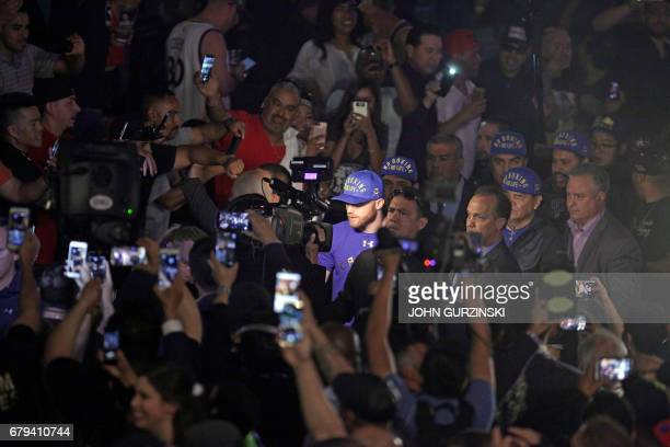 Fans use their phones to record Saul 'Canelo' Alvarez as he arrives for his weighin with Julio Cesar Chavez Jr Friday May 5 2017 at the MGM Grand...