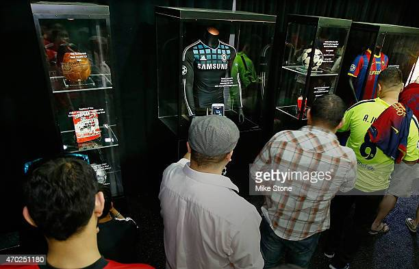Fans view player jerseys and memorabilia at the 2015 UEFA Champions League Trophy Tour presented by Heineken exhibition on April 18 2015 in Dallas...