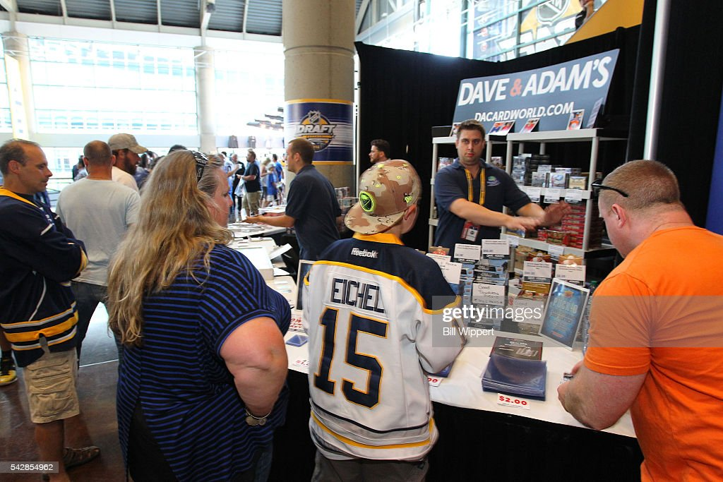 Fans visit a booth prior to round one of the 2016 NHL Draft at First Niagara Center on June 24, 2016 in Buffalo, New York.