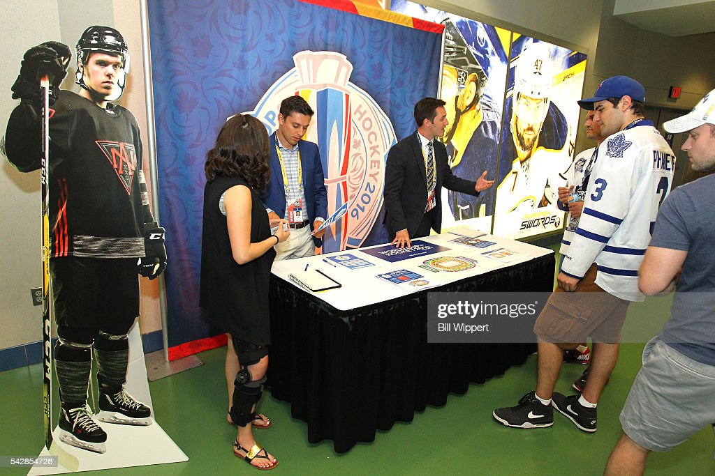 Fans visit the 2016 World Cup of Hockey booth prior to round one of the 2016 NHL Draft at First Niagara Center on June 24, 2016 in Buffalo, New York.