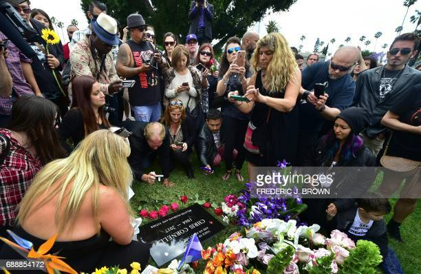 Fans visit the grave of Chris Cornell at Hollywood Forever Cemetery following a funeral service earlier in the day for the Soundgarden frontman on...