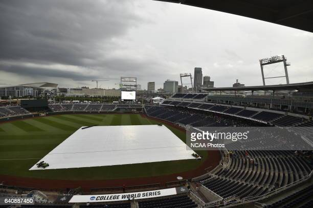 Fans wait around due to weather conditions before the start of Game 3 between the University of Arizona and Coastal Carolina University during the...