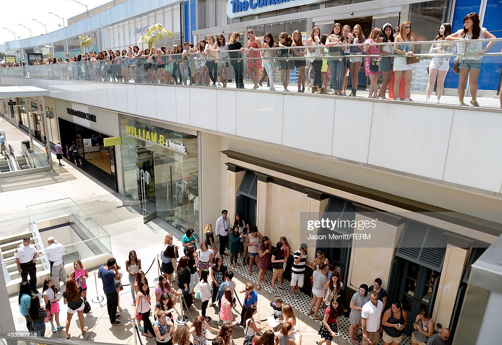 Fans wait as Lucy Hale appears at the Hollister store at Westfield Century City Mall to launch her collection on August 9 2014 in Los Angeles...