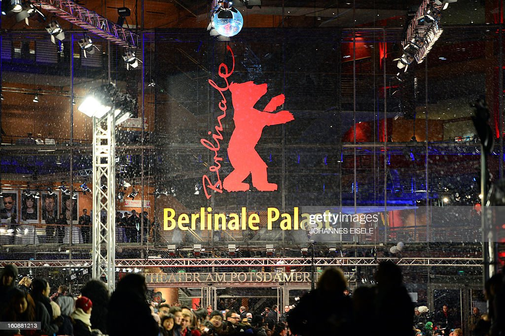 Fans wait at the red carpet of the opening film of the Berlinale film festival , 'Yi dai zong shi' (The Grandmaster) in Berlin, on February 7, 2013