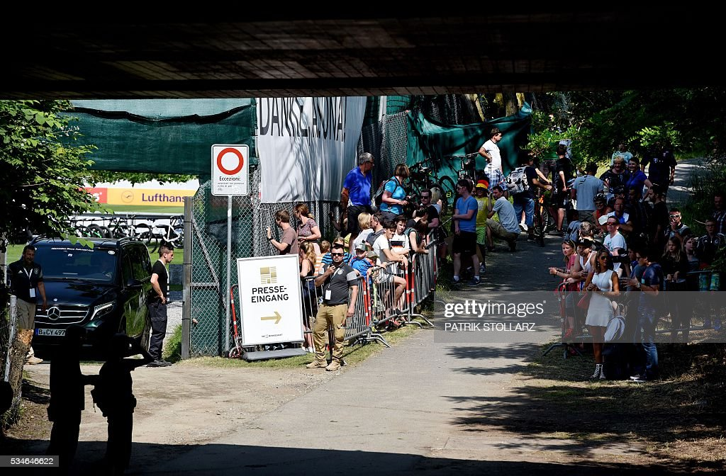 Fans wait at the training ground for the German players prior to a training session as part of the team's preparation for the upcoming Euro 2016 European football championships, on May 27, 2016 in Ascona. / AFP / PATRIK