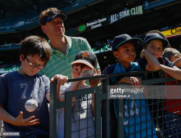Fans wait for an autograph prior to the game between the Seattle Mariners against the Baltimore Orioles at Safeco Field on July 27 2014 in Seattle...