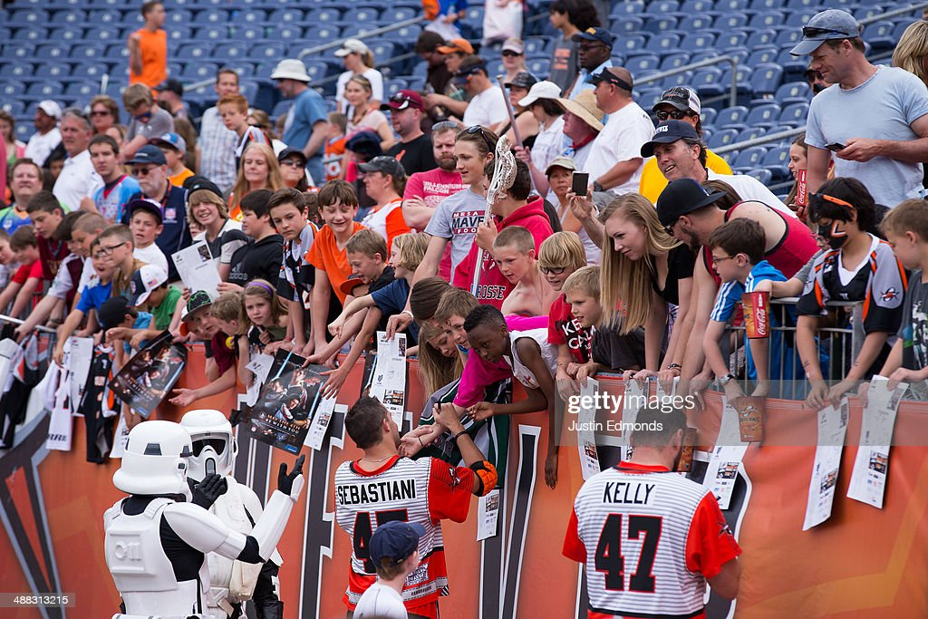 Fans wait for autographs after a game between the Ohio Machine and Denver Outlaws at Sports Authority Field at Mile High on May 4, 2014 in Denver, Colorado. The teams wore Star Wars themed jerseys in honor of 'May The 4th Be With You Day.' The Outlaws defeated the Machine 14-12.