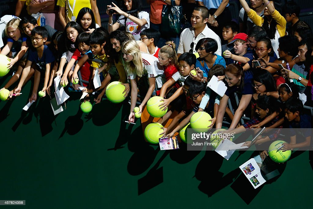 Fans wait for autographs after Serena Williams of USA defeats Caroline Wozniacki of Denmark in the semi finals during day six of the BNP Paribas WTA...