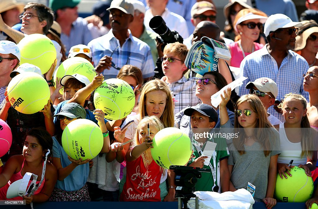 Fans wait for autographs on Day Four of the 2014 US Open at the USTA Billie Jean King National Tennis Center on August 28 2014 in the Flushing...