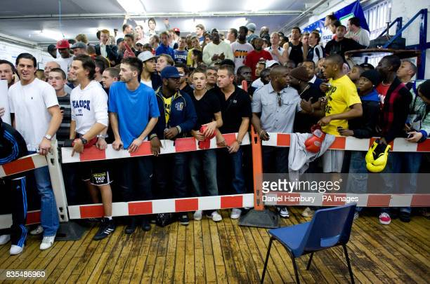Fans wait for Floyd Mayweather Jnr during the media work out at the Peacock Gym London