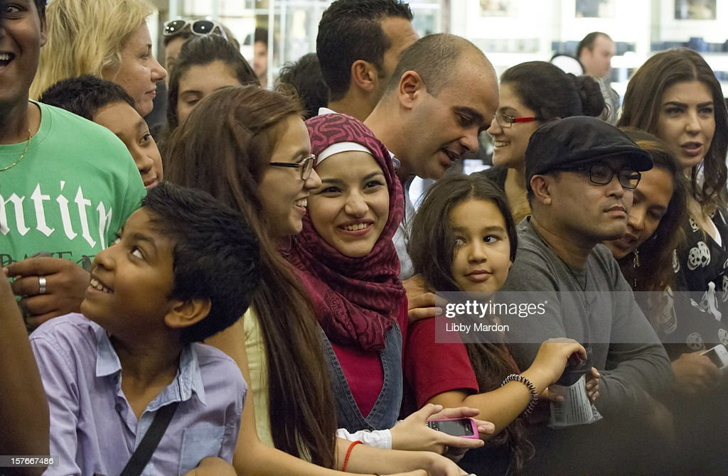 Fans wait for Gwyneth Paltrow to make an in store appearance for Boss Nuit at Paris Gallery, Dubai Mall on December 5, 2012 in Dubai, United Arab Emirates.