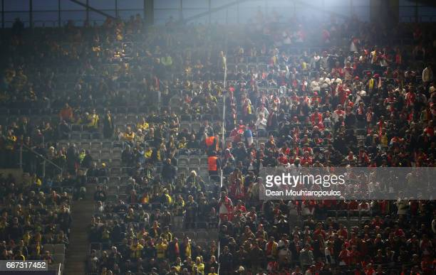 Fans wait for news on inside the stadium after an explosion near the Borussia Dortmund team coach prior to the UEFA Champions League Quarter Final...
