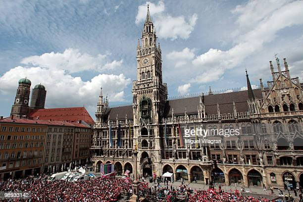 Fans wait in front of the city hall for the players of Bayern Muenchen to present the German championship trophy on the balcony of the city hall...