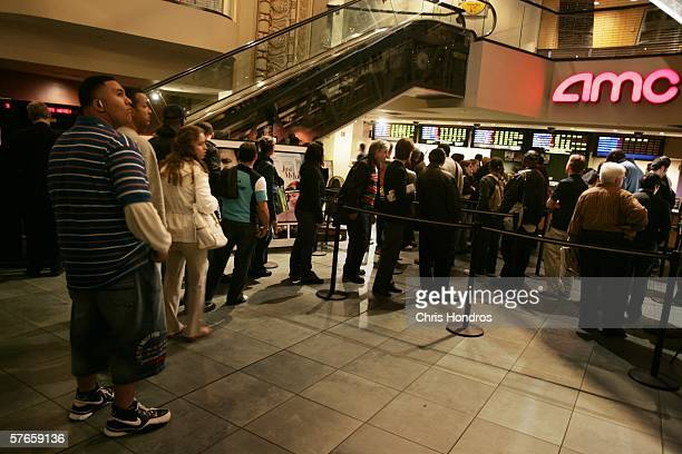 Fans wait in line to buy remaining tickets to popular movies including 'The Da Vinci Code' May 19 2006 at the AMC Theaters on 42nd Street in New York...