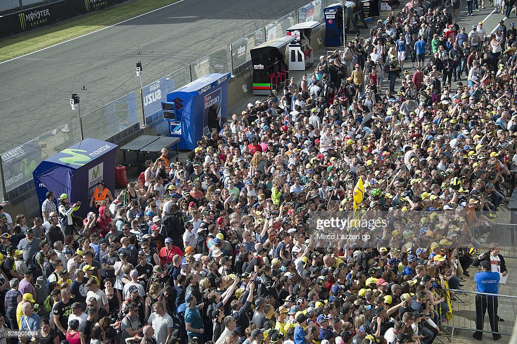 Fans wait in pit for the autographs session during the MotoGp of France - Press Conference on May 5, 2016 in Le Mans, France.