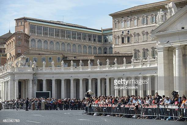 Fans wait in Saint Peter's Square the arrival of Queen Elizabeth II on April 3 2014 in Rome Italy During their brief visit The Queen and the Duke of...