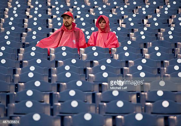 Fans wait in the rain prior to the game between the Chicago Cubs and Philadelphia Phillies on September 12 2015 at Citizens Bank Park in Philadelphia...