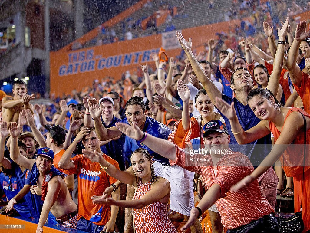 Fans wait in the stands during a weather delay prior to the game between the Florida Gators and the Idaho Vandals on August 30 2014 in Gainesville...