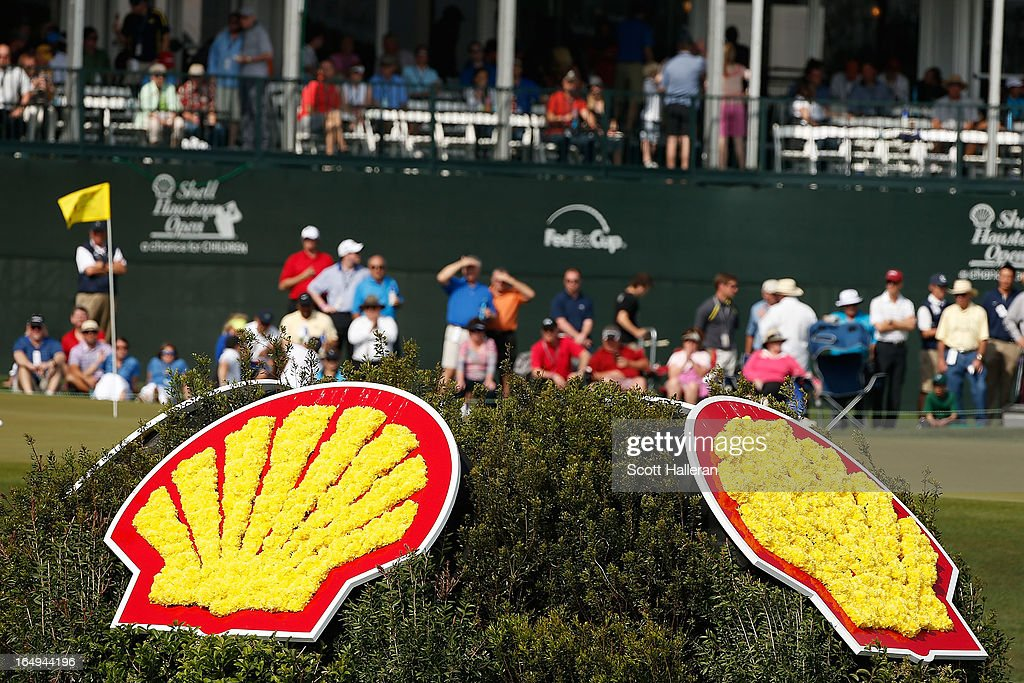 Fans wait near the 18th green during the second round of the Shell Houston Open at the Redstone Golf Club on March 29, 2013 in Humble, Texas.