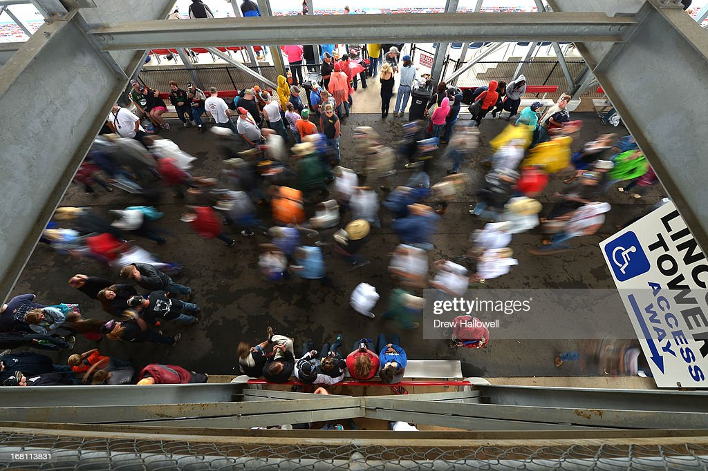 Fans wait out a rain delay at the NASCAR Sprint Cup Series Aaron's 499 at Talladega Superspeedway on May 5, 2013 in Talladega, Alabama.