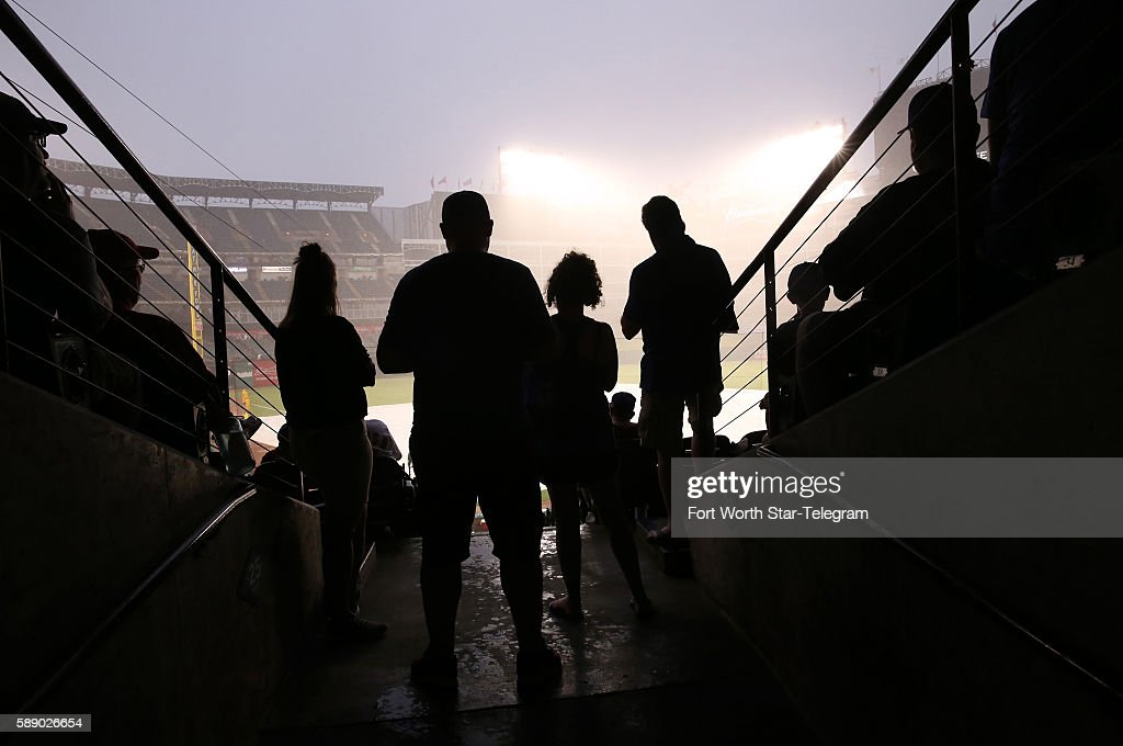 Fans wait out a rain delay before the Detroit Tigers and Texas Rangers play at Globe Life Park in Arlington Texas on Friday Aug 12 2016