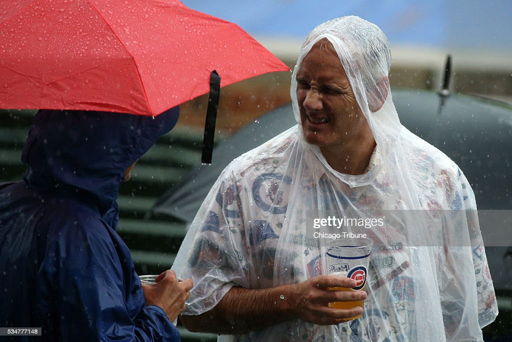 Fans wait out a rain delay during the seventh inning as the Chicago Cubs play host to the Philadelphia Phillies on Friday, May 27, 2016, at Wrigley Field in Chicago.