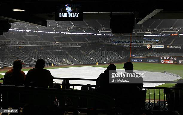 Fans wait out a rain delay during the sixth inning of the game between the New York Mets and the Atlanta Braves on April 25 2010 at Citi Field in the...