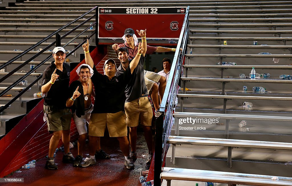 Fans wait out a weather delay between the North Carolina Tar Heels and South Carolina Gamecocks at Williams-Brice Stadium on August 29, 2013 in Columbia, South Carolina.