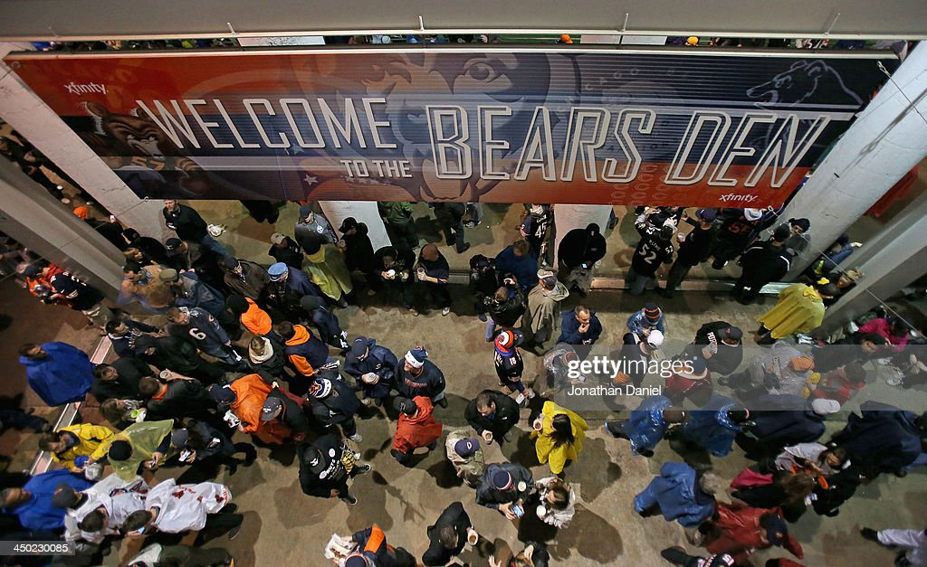Fans wait out a weather delay of a game between the Chicago Bears and the Baltimore Ravens at Soldier Field on November 17, 2013 in Chicago, Illinois.