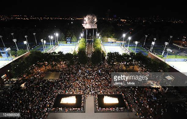 Fans wait outside of Arthur Ashe stadium prior to the start of the night session during Day Thirteen of the 2011 US Open at the USTA Billie Jean King...