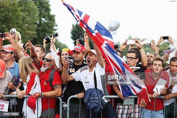 Fans wait outside the paddock gates for autographs before the Italian Formula One Grand Prix at Autodromo di Monza on September 8 2013 in Monza Italy