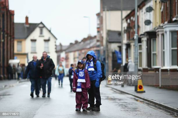 Fans wait outside the stadium prior to the Premier League match between Everton and Hull City at Goodison Park on March 18 2017 in Liverpool England