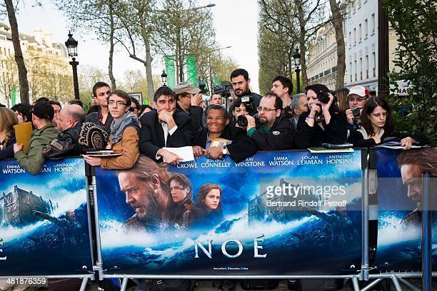 Fans wait outside the theater prior to the Paris premiere of 'Noah' directed by Darren Aronofsky at Cinema Gaumont Marignan on April 1 2014 in Paris...
