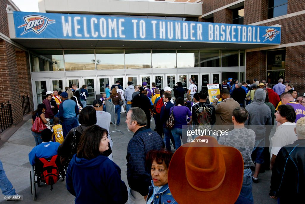 Fans wait to enter the Ford Center for a National Basketball Association (NBA) game between the Los Angeles Lakers and the Oklahoma City Thunder in Oklahoma City, Oklahoma, U.S., on Tuesday, March 24, 2009. Nearly three decades after an energy bust that forced 122 banks to close statewide, Oklahoma City is in the fifth year of an economic expansion that's produce the lowest jobless rate for a major metro U.S. area. Oklahoma City demonstrated it could support a NBA team, encouraging the Seattle Supersonics to move permanently and become the Thunder, which now draw crowds as large as the Boston Celtics.