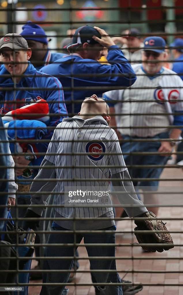 Fans wait to enter Wrigley Field before the Opening Day game between the Chicago Cubs and the Milwaukee Brewers on April 8, 2013 in Chicago, Illinois.