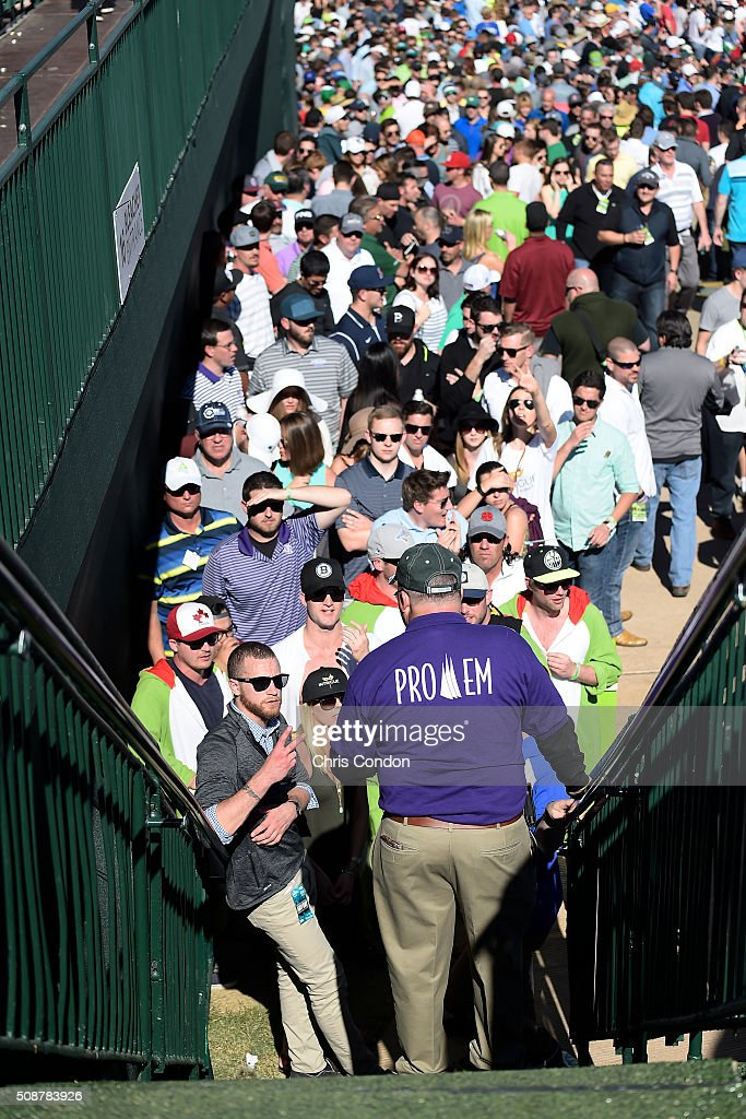 Fans wait to get into the 16th hole grandstands during the third round of the Waste Management Phoenix Open, at TPC Scottsdale on February 6, 2016 in Scottsdale, Arizona.