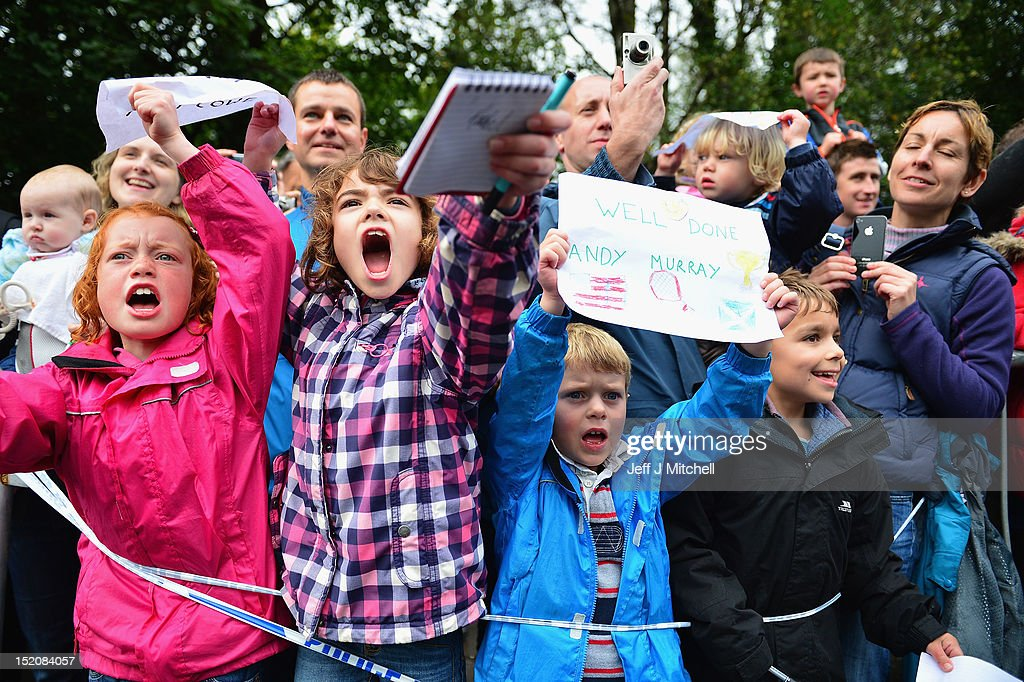 Fans wait to see tennis player Andy Murray as he returns to Dunblane following his win in the US Open and his gold medal in the 2012 Olympic games in London, on September 16, 2012 in Dunblane, Scotland. Thousands lined the streets of his hometown as the 25 year old returned to meet with family and friends following his summer triumphs.