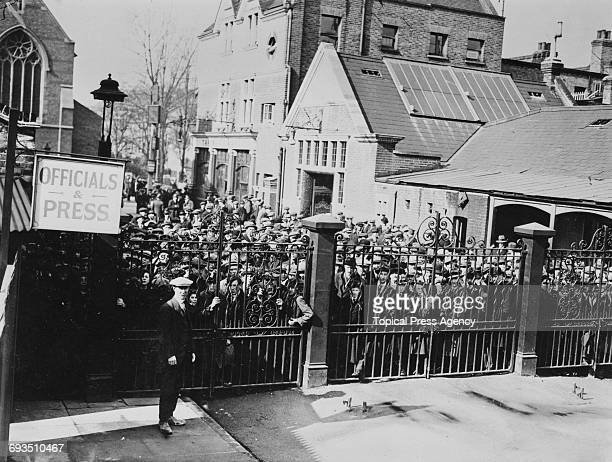 Fans waiting at the gates outside Tottenham Hotspur's White Hart Lane ground London before Spurs' FA Cup replay against Cardiff City 9th March 1922...