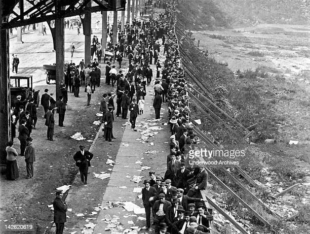 Fans waiting in line at the Polo Grounds for tickets for the first game of the 1912 World Series between the New York Giants and the Boston Red Sox...