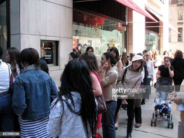 Fans waits outside Barney's department store on Madison Avenue New York in preparation for the launch of the Kate Moss Topshop collection in America