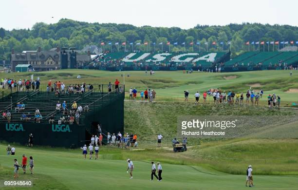 Fans walk across the course during a practice round prior to the 2017 US Open at Erin Hills on June 14 2017 in Hartford Wisconsin