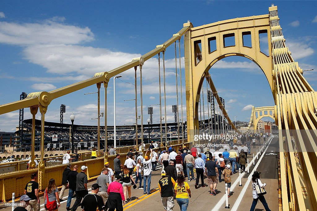 Fans walk across the Roberto Clemente bridge prior to the Opening Day game between the Pittsburgh Pirates and the Detroit Tigers at PNC Park on April...